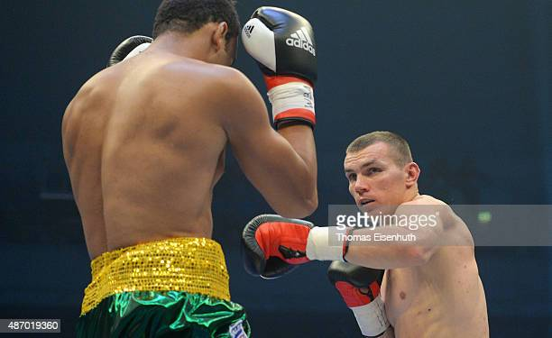 Mateusz Masternak of Poland exchanges punches with Carlos Nascimento of Brazil during their WBA intercontinental cruiserweight championship at the...
