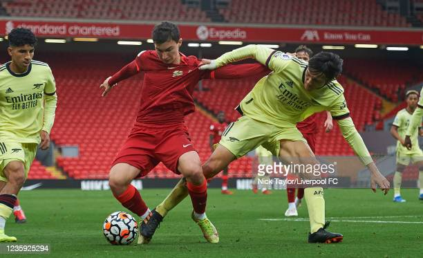 Mateusz Muaislowski of Liverpool and Joel Lopez of Arsenal in action during the PL2 game at Anfield on October 16, 2021 in Liverpool, England.