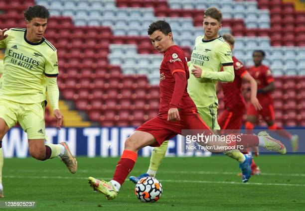 Mateusz Muaislowski of Liverpool and Omar Rekik of Arsenal in action during the PL2 game at Anfield on October 16, 2021 in Liverpool, England.