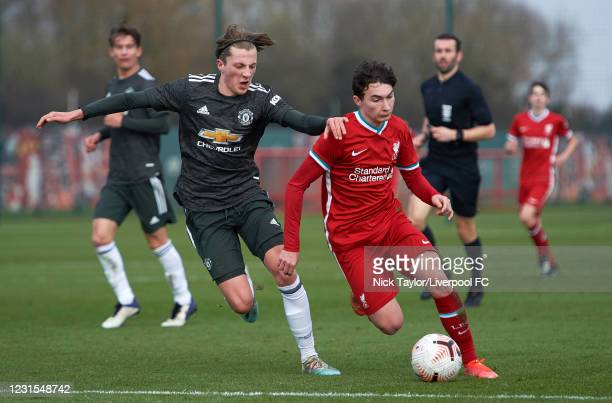 Mateusz Musialowski of Liverpool and Charlie Savage of Manchester United in action during the U18 Premier League game between Liverpool and...