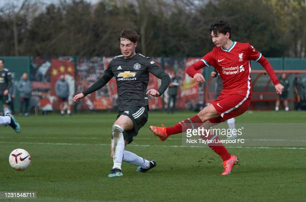 Mateusz Musialowski of Liverpool and Iestyn Hughes of Manchester United in action during the U18 Premier League game between Liverpool and Manchester...