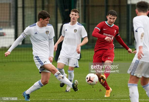 Mateusz Musialowski of Liverpool and Joe Littlewood of Leeds United in action at Melwood Training Ground on November 21, 2020 in Liverpool, England.