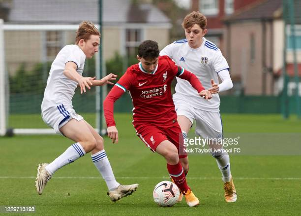 Mateusz Musialowski of Liverpool and Joe Snowdon and Max Dean of Leeds United in action at Melwood Training Ground on November 21, 2020 in Liverpool,...