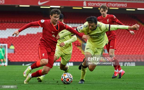 Mateusz Musialowski of Liverpool and Joel Lopez of Arsenal in action during the PL2 game at Anfield on October 17, 2021 in Liverpool, England.