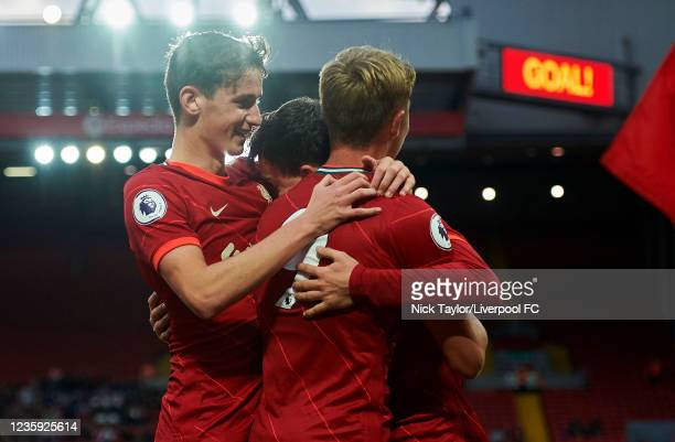 Mateusz Musialowski of Liverpool celebrates scoring Liverpool's first goal with Tyler Morton and Paul Glatzel during the PL2 game at Anfield on...