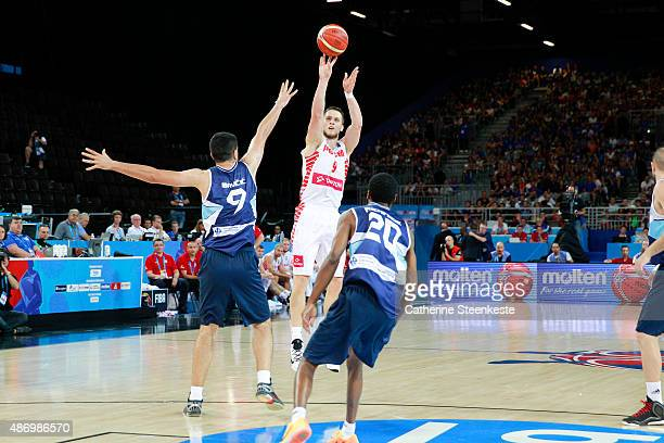 Mateusz Ponitka of Poland shoots for three points against Edin Bavcic and Alex Renfroe of Bosnia and Herzegovina during the EuroBasket Group Phase...