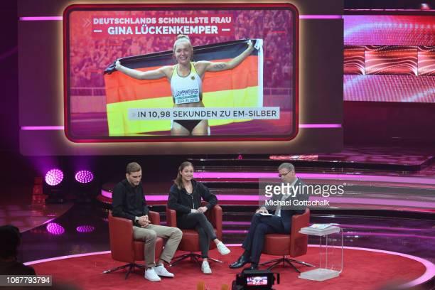Mateusz Przyvylko Gina Lückenkemper and Günther Jauch speak on stage during the tv show '2018 Menschen Bilder Emotionen' on December 3 2017 in...