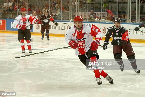 Mateusz Rompkowski of Comarch Cracovia skates with Jaroslav Hlinka of HC Sparta Prague during the Champions Hockey League match between Sparta Prague...