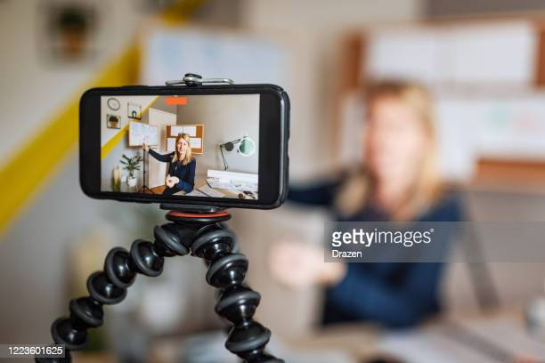 math professor at home, looking and talking direct to camera during online classroom - remote location stock pictures, royalty-free photos & images