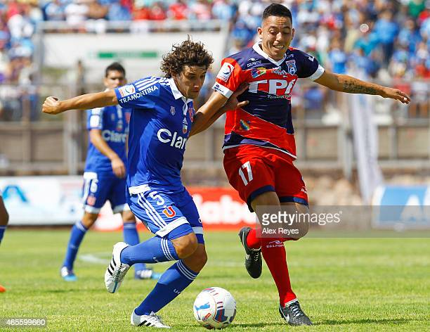 Mathías Corujo of U de Chile fights for the ball with Sebastián Rivera of San Marcos de Arica during a match between San Marcos de Arica and U de...