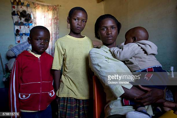 Mathato Notsi with her children five year old boy Lebenja nine year old girl Thato and 10 month old Mpho at home Mathato discovered that she and her...