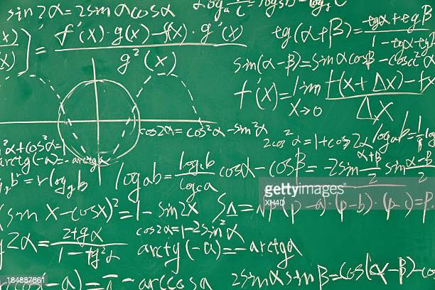 mathematical formula on green blackboard - physics stock pictures, royalty-free photos & images