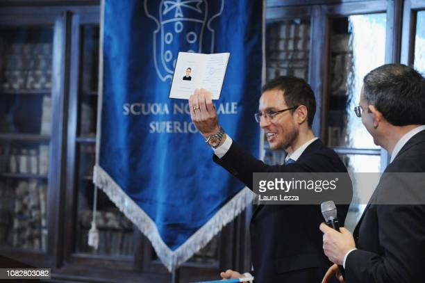Mathematician Alessio Figalli attends the Conference 'Alessio Figalli Fields medallist 2018' and shows his student booklet at the Scuola Normale...
