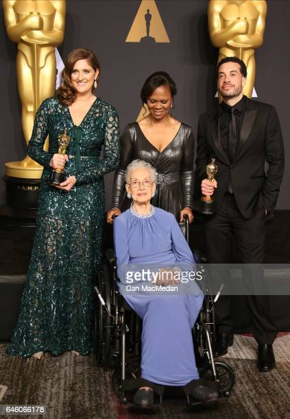 Mathematician Katherine Johnson and director Ezra Edelman and producer Caroline Waterlow , winners of Best Documentary Feature for 'O.J.: Made in...