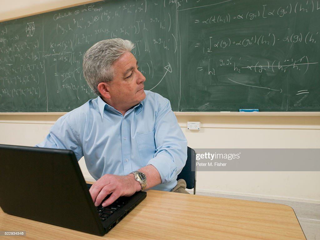 Mathematician Working in Classroom : Stock Photo