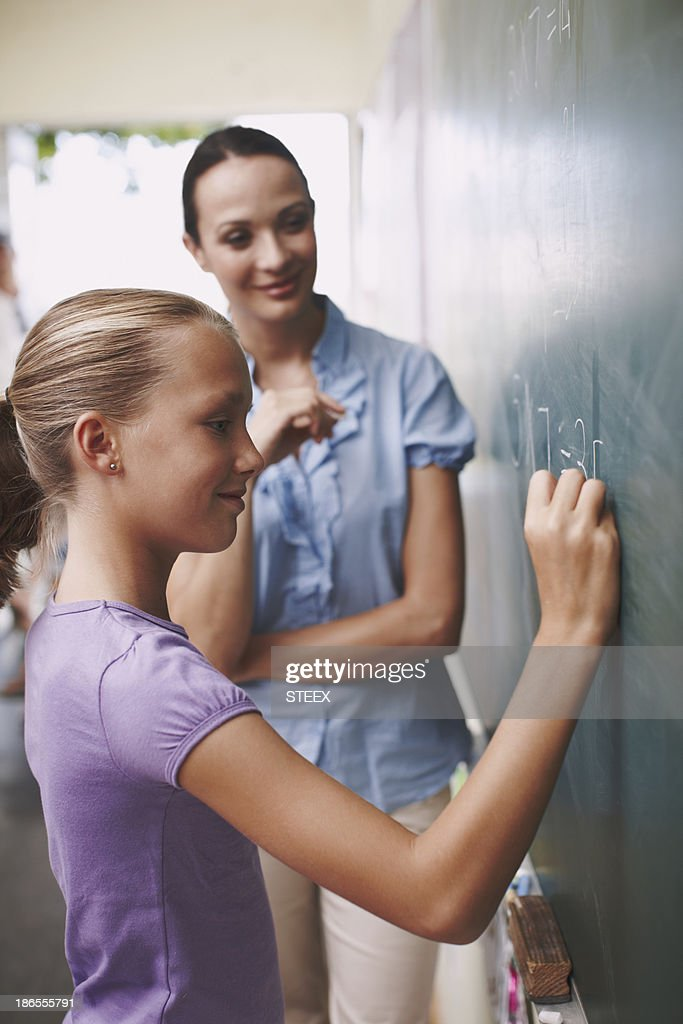Mathematics is important for her future : Stock Photo