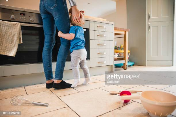 Mather and Baby Son Standing In The Kitchen