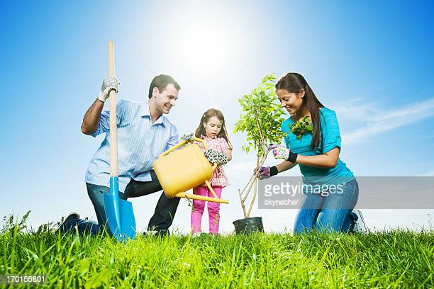 Mather, father and their daughter gardening on beautiful day