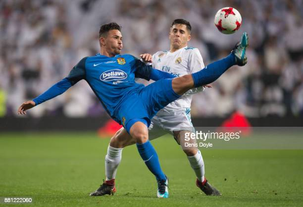 Matheus Aias Barrozo tackles Alvaro Tejero of Real Madrid during the Copa del Rey Round of 32 Second Leg match between Real Madrid and Fuenlabrada at...