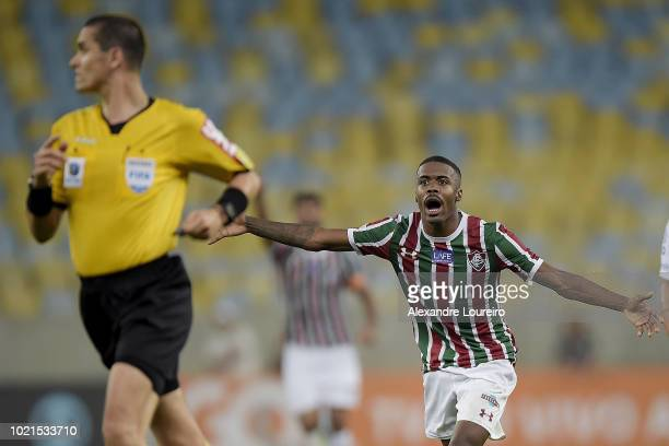 Matheus Alessandro of Fluminense of Fluminense telks with the referee Ricardo Marques Ribeiro during the match between Fluminense and Corinthians as...
