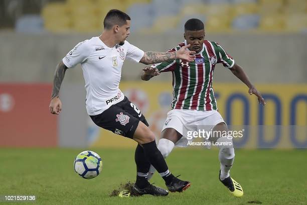 Matheus Alessandro of Fluminense struggles for the ball with Fagner of Corinthians during the match between Fluminense and Corinthians as part of...