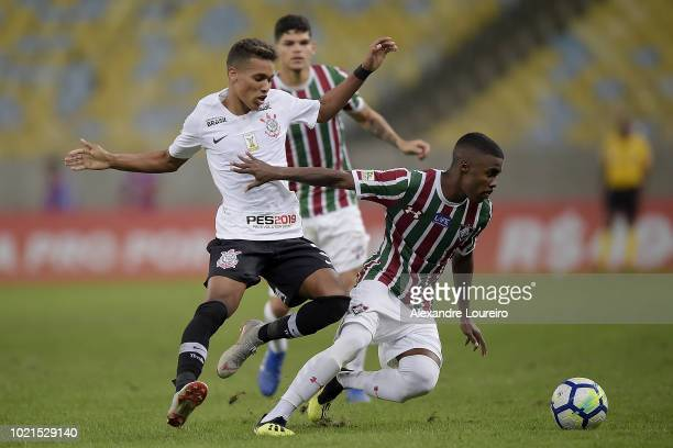 Matheus Alessandro of Fluminense struggles for the ball with Pedrinho of Corinthians during the match between Fluminense and Corinthians as part of...