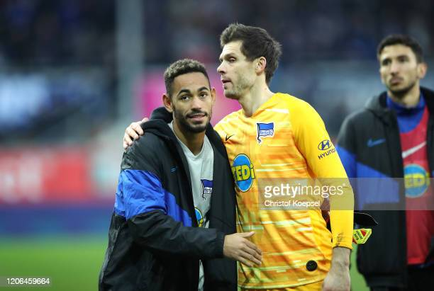 Matheus Cunha and Rune Almenning Jarstein of Hertha BSC celebrate following their sides victory in the Bundesliga match between SC Paderborn 07 and...