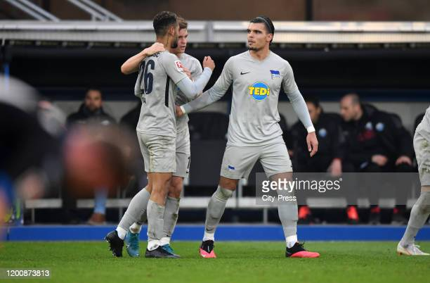 Matheus Cunha Maximilian Mittelstaedt and Karim Rekik of Hertha BSC celebrate after scoring the 12 during the game between the SC Paderborn 07...