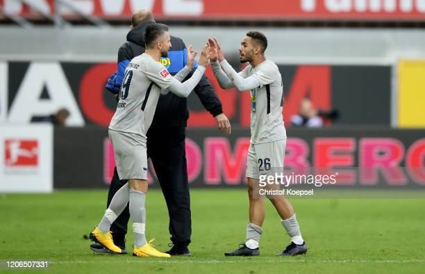 Matheus Cunha of Berlin is substituted against Vedad Ibisevic of Berlin during the Bundesliga match between SC Paderborn 07 and Hertha BSC at...