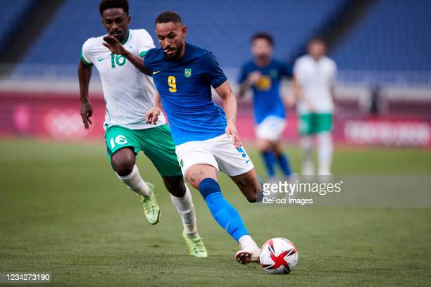 Matheus Cunha of Brazil and Khalifah Aldawsari of Saudi Arabia battle for the ball during the Men's Group D match between Saudi Arabia and Brazil on...