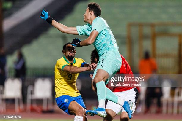 Matheus Cunha of Brazil battles for the ball with Goalkeeper Mahmoud Gad of Egypt during the match between Egypt U23 and Brazil U23 at Cairo...