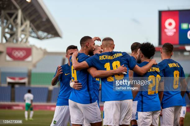 Matheus Cunha of Brazil celebrates after scoring his team's first goal with teammates during the Men's Group D match between Saudi Arabia and Brazil...