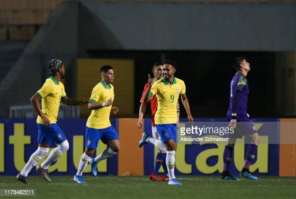 Matheus Cunha of Brazil celebrates with teammates after scoring the first goal of his team during the Olympic Soccer Friendly match against Chile at...