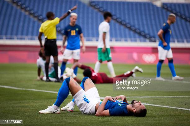 Matheus Cunha of Brazil on the ground during the Men's Group D match between Saudi Arabia and Brazil on day five of the Tokyo 2020 Olympic Games at...