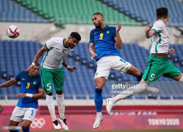 Matheus Cunha of Brazil scores his team's first goal during the Men's Group D match between Saudi Arabia and Brazil on day five of the Tokyo 2020...