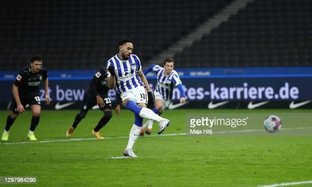 Matheus Cunha of Hertha Berlin shoots a penalty and has the penalty saved by Jiri Pavlenka of Werder Bremen during the Bundesliga match between...