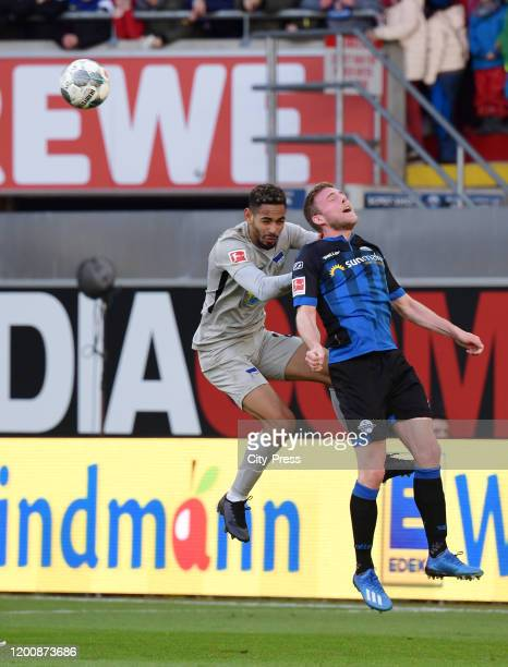 Matheus Cunha of Hertha BSC and Laurent Jans of SC Paderborn during the game between the SC Paderborn 07 against Hertha BSC on february 15 2020 in...