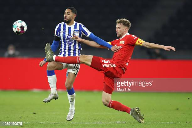 Matheus Cunha of Hertha is challenged by Marvin Friedrich of Union during the Bundesliga match between Hertha BSC and 1. FC Union Berlin at...