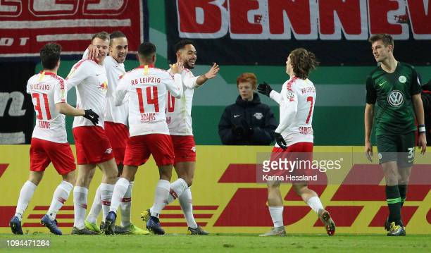 Matheus Cunha of Leipzig celebrates the opening goal with teammates during the DFB Cup between RB Leipzig and VfL Wolfsburg at Red Bull Arena on...
