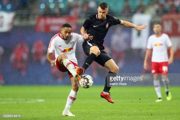 Matheus Cunha of Leipzig is challenged by Vladyslav Kochergin of Zorya during the UEFA Europa League Qualifying PlayOff second leg match between RB...