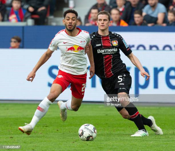 Matheus Cunha of RB Leipzig and Sven Bender of Bayer 04 Leverkusen battle for the ball during the Bundesliga match between Bayer 04 Leverkusen and RB...