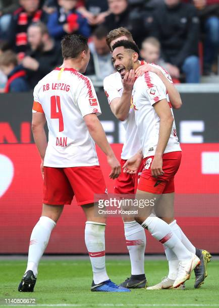 Matheus Cunha of RB Leipzig celebrates after scoring his team's fourth goal with Willi Orban of RB Leipzig during the Bundesliga match between Bayer...