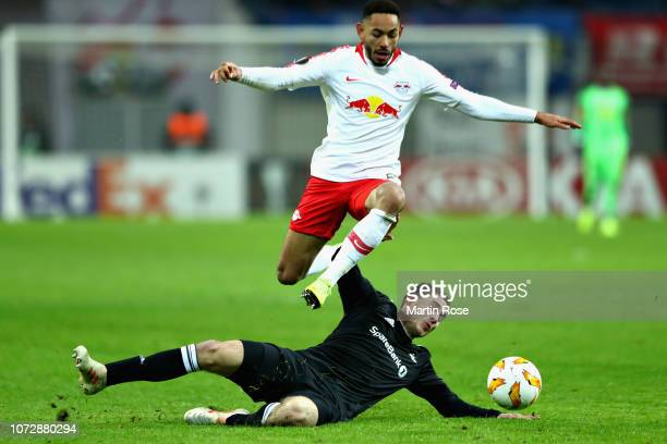 Matheus Cunha of RB Leipzig jumps over Even Hovland of Rosenborg during the UEFA Europa League Group B match between RB Leipzig and Rosenborg at Red...