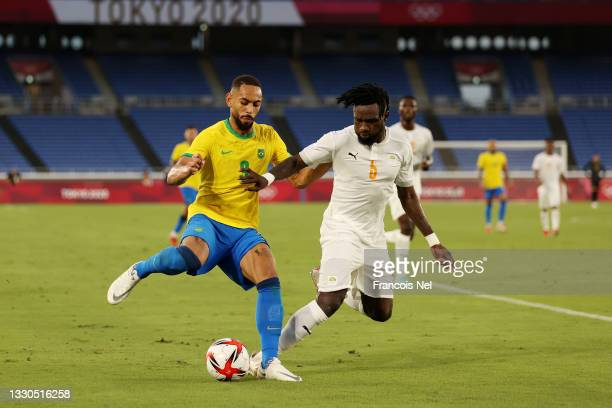 Matheus Cunha of Team Brazil battles for possession with Ismael Diallo of Team Ivory Coast during the Men's First Round Group D match between Brazil...