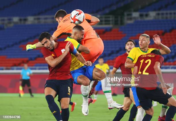 Matheus Cunha of Team Brazil is fouled by Unai Simon of Team Spain leading to a penalty being awarded during the Men's Gold Medal Match between...