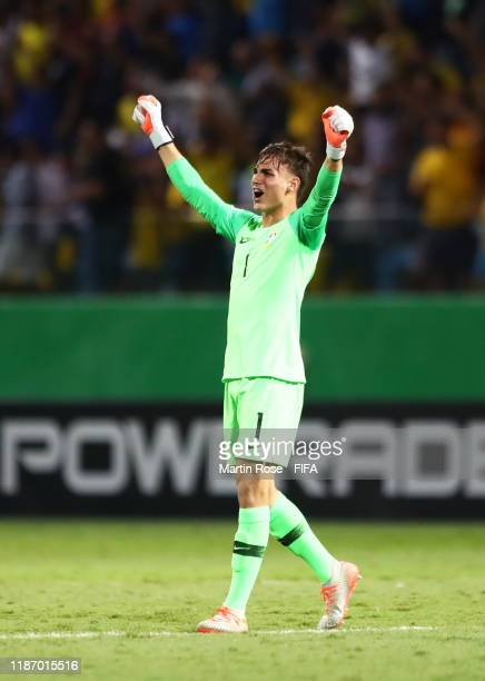 Matheus Donelli of Brazil celebrates his sides second goal scored by Peglow of Brazil during the FIFA U17 World Cup Quarter Final match between Italy...