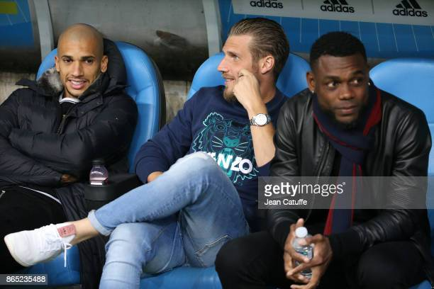 Matheus Doria Macedo Gregory Sertic Henri Bedimo of OM sit on the bench during the French Ligue 1 match between Olympique de Marseille and Paris...
