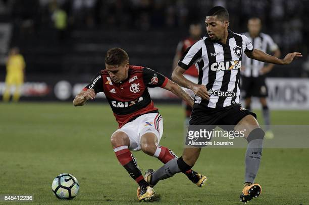 Matheus Fernandes of Botafogo battles for the ball with [Gustavo Cuéllar of Flamengo during the match between Botafogo and Flamengo as part of...