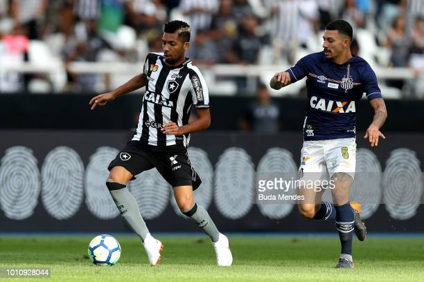 Matheus Fernandes of Botafogo struggles for the ball with Alison of Santos during a match between Botafogo and Santos as part of Brasileirao Series A...