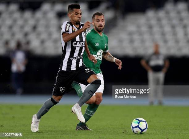 Matheus Fernandes of Botafogo struggles for the ball with Canteros of Chapecoense during a match between Botafogo and Chapecoense as part of...